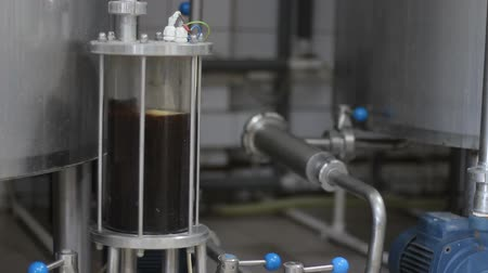 microbrewery : Craft beer brewing. Filtration of brewed beer. Brewing equipment in action. Close-up