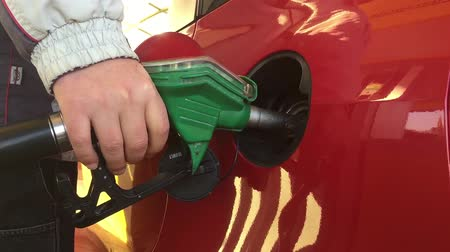 petrol : Red car at gas station being filled with fuel Stock Footage