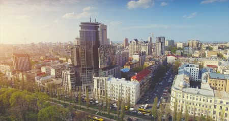 Aerial Drone Flight Footage: Picturesque cityscape of old central town in soft sunset light. Flight over the Boulevard of Taras Shevchenko, Kiev, Ukraine, Europe. Camera go down. 4K resolution.