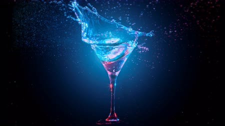Bright modern cocktail with lemon falling in glass, splashing water on dark background. Blue and red color mixed light. Drops, bokeh and glare moves on the frame. Frozen in motion. Slow motion 4K