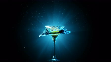 speck : Modern cocktail with lemon fall in glass, splashing water on dark background. Blue light beams, drops, bokeh and glare move on the frame. Entertainment and relaxation. Frozen in motion. Slow motion 4K