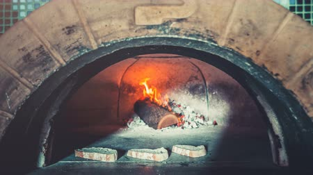 coal fired : Food concept. Traditional professional oven with open fire for making italian pizza in restaurant kitchen. Three slices of white homemade bread warming up inside. Zoom. 4k Slow Motion Parallax Effect Stock Footage