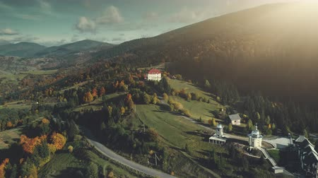 Mountain Village Wild Valley Aerial View. Multicolored Autumn Nature Hill Slope Landscape Overview. Panoramic Rural Highland Clean Environment Travel Concept. Zoom out Drone Flight Footage 4K (UHD)