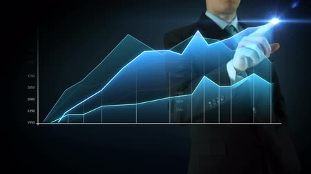 Businessman on an abstract blue background interactivity touch screen and draws blue big graph. Touchscreen Technology motion graphics growing market.