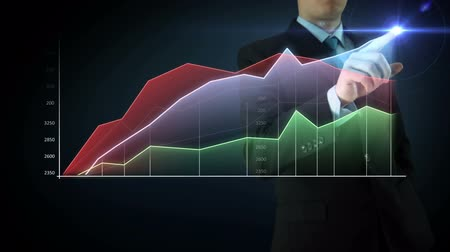 Businessman on an abstract blue background interactivity touch screen and draws big color graph. Touchscreen Technology motion graphics growing market.