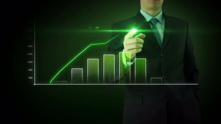 Businessman on an abstract green background interactivity touch screen and draws green big bar graph. Touchscreen Technology motion graphics growing market.