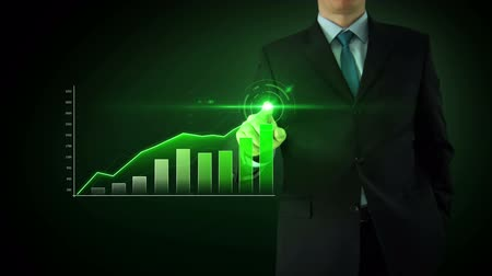 zvýšení : Businessman on an abstract green background interactivity touch screen and draws green bar graph. Touchscreen Technology motion graphics growing market.