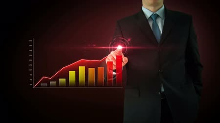Businessman on an abstract red background interactivity touch screen and draws red bar graph. Touchscreen Technology motion graphics growing market.