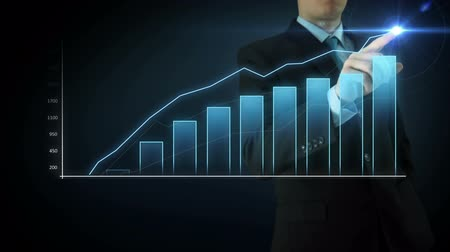 Businessman on an abstract blue background interactivity touch screen and draws Blue big bar graph. Touchscreen Technology motion graphics growing market.
