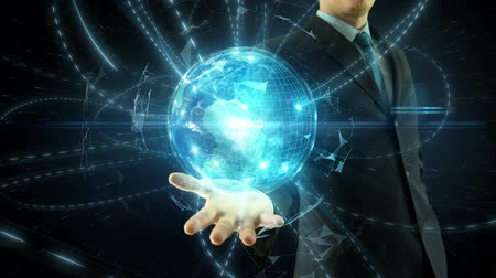 Businessman hold over hand animated global digital link social network media and internet network concept over space globe Dostupné videozáznamy