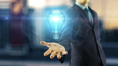 Business man creative new idea solution concept with bulb animation on hand