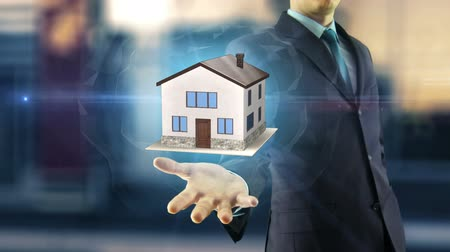 real : Business man new mortgage house concept with animation on hand buy new house