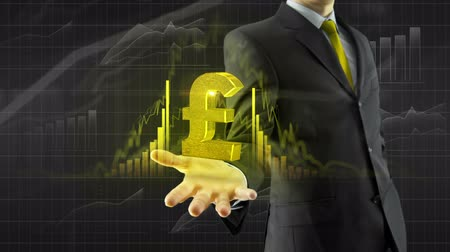 esterlino : Business man trader hold growing english pound sterling currency on hand with animated grow and graph bars trade concept