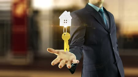anlaşma : Business man new keys hold on hand mortgage house concept with animation, buy new house Stok Video