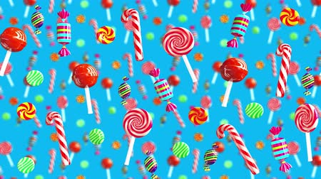colorful candy : Bright glamour sweet juicy candies lollipop chupa chups caramel toffee sugar move from right to left. High quality background. Candy on blue.
