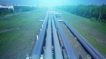 chp : AERIAL Pipes with hot water. Heat carrier steel pipes from CHP, heat and power centers supply heat and water to the city. Top view. Stock Footage