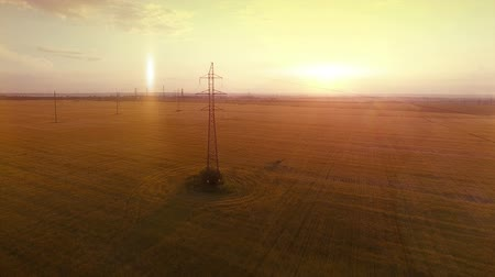 yakın : AERIAL High-voltage tower summer warm evening light camera fly near electricity cable line and metal structure