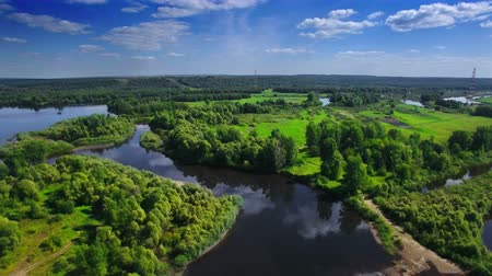 fly fishing : AERIAL Fly over clear blue river and green native forest in middle Europe, Russia, Tatarstan Stock Footage