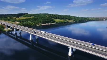 AERIAL Fly over traffic bridge highway roadway road way and blue river with trees forest, Europe, Russia, Tatarstan