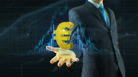 Business man, businessman hold euro icon on hand growth of quotations, currency, exchange grow up concept