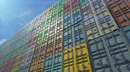 Stack of containers in a harbor, shipping at dockyard, logistic import and export, in normal day color, bottom angle view
