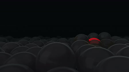 герои : One red balloon is opposed by many other balloons. Dark background. Ideal title text background. One against all. Concept ideas. The concept of personality. Use mask to easy change color.