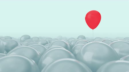 personalidade : One red balloon is opposed by many other balloons. Bright blue light background. Ideal title text background. One against all. Concept ideas. The concept of personality. Use mask to easy change color. Stock Footage
