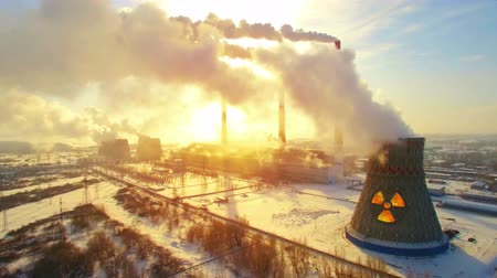 trąbka : Aerial panoramic flight of hyperlaps around the nuclear power plant. Winter carbon dioxide emissions, Energy of smoke and steam, sun shines through clouds of smoke. Ecology and pollution of nature.