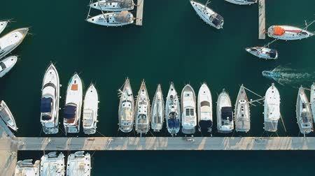 regaty : Aerial view of yacht club and marina in Croatia, Split bay. Small boat is maneuvering between large boats.