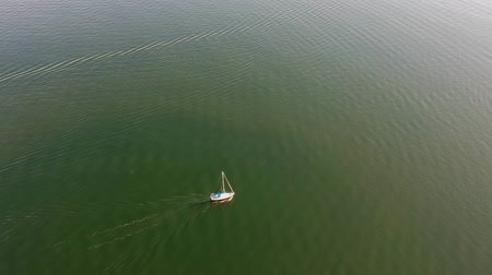 yat yarışı : Sailing ship yacht with sails at open sea. Aerial drone view of sailboat at summer.