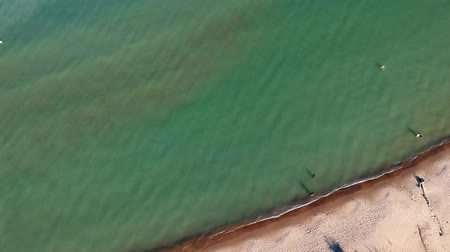adriyatik : Aerial view of sandy beach with tourists swimming in beautiful sea water. Top view of people sunbathing on the beach summer travel holidays bird eye view.