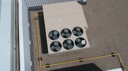 condicionador : Aerial top view footage of AC exhaust vents of industrial air conditioning and ventilation at roof at hot summer day.