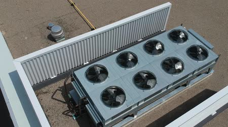 escape : Aerial top view footage of AC exhaust vents of industrial air conditioning and ventilation at roof at hot summer day.