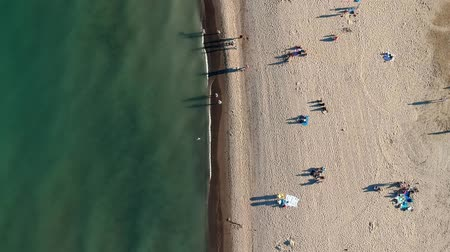 földközi tenger : Aerial view of sandy beach with tourists swimming in beautiful green water. Top view of people sunbathing lying down on the tropical beach summer travel holidays bird eye view.