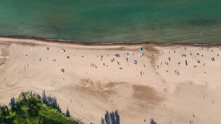adriyatik : Aerial view of sandy beach with tourists swimming in beautiful green water. Top view of people sunbathing lying down on the tropical beach summer travel holidays bird eye view.