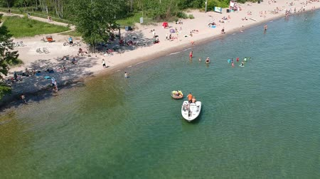 mech : Aerial view of sandy beach with tourists swimming in beautiful clear water. Top view of people sunbathing lying down on the tropical beach summer travel holidays bird eye view.