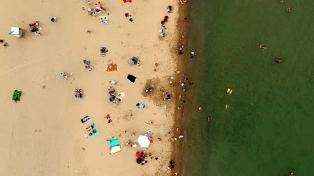 földközi tenger : Aerial view of sandy beach with tourists swimming in beautiful clear water. Top view of people sunbathing lying down on the tropical beach summer travel holidays bird eye view.