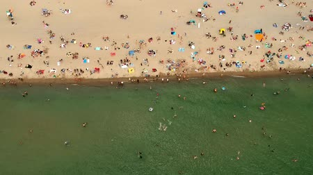 adriyatik : Aerial view of sandy beach with tourists swimming in beautiful clear water. Top view of people sunbathing lying down on the tropical beach summer travel holidays bird eye view.