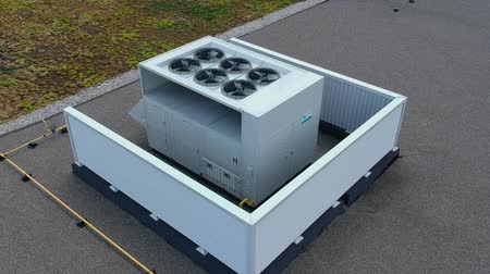 compressor : Aerial top view footage of AC exhaust vents of industrial air conditioning and ventilation at roof at hot summer day.