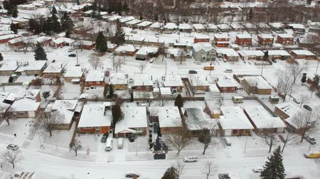 fenomen : High level of snow storm, winter weather forecast alert day in the city. Top aerial view of people houses covered in snow, bird eye view suburb urban housing development. Quite neighbourhood.