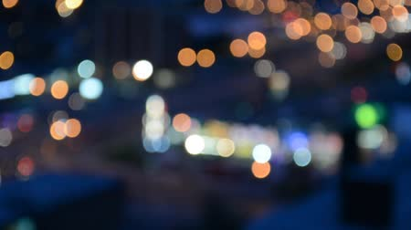 yuvarlak : City of Toronto blur background. Moving bokeh circles of night traffic and travelling circus in the plaza. Illuminated summer night traffic streets introspection.