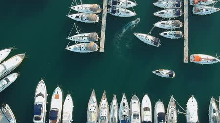 регата : Aerial view of yacht club and marina in Croatia, Split bay. Small boat is maneuvering between large boats.