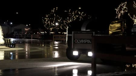 Toronto, Ontario, Canada - December 30th, 2018: Ice machine cleans the skating rink, ice combine refreshes ice skating field at winter festival.