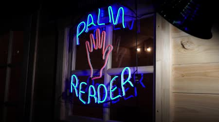 hippie : Neon light palm reader fortune teller sign on the window with flashing palm. Stock Footage