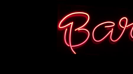 Neon sign Bar in red color sliding, neon symbol for beer and alcohol.