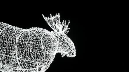 mitologia : Moose statue made of winter Christmas decorations garlands or neon lights. Light festival in Toronto, Ontario, Canada, amusement park, Ontario place theme park. A lot of light bulbs.