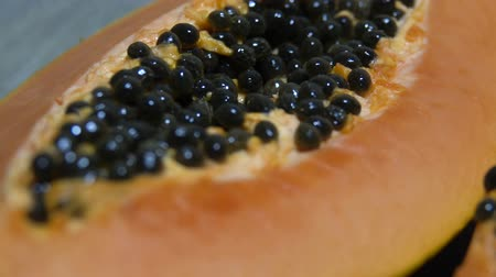 etli : Fresh sliced papaya with seeds inside closeup. Half of yellow papaya. Panning video
