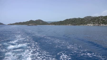 수경 : Cruise ship trace with calm sea. View of the Turkish rocky coast near the island of Kekova. Slow motion