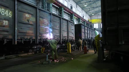 train workers : Stock Video Footage in wagon repairing train factory