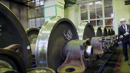 train workers : Stock Video Footage in wagon repairing train factory.mp4